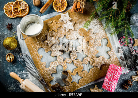 Christmas traditions homemade baking Cooking gingerbread star cookies, gingerbread men, flat lay, top view, with accessories ingredients for baking. D - Stock Photo
