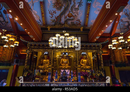 Golden Buddha statues and altar in the Main Shrine Hall of Po Lin Monastery. Hong Kong, Ngong Ping, Lantau Island, January 2018 - Stock Photo