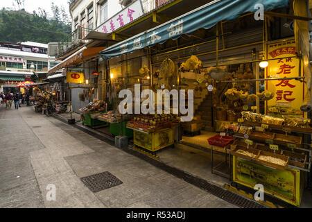 Market street at Tai O fishing village, with shops selling dry seafood. Tai O, Lantau Island, Hong Kong, January 2018 - Stock Photo