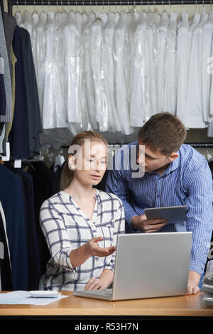 Couple Running On Line Fashion Business Working In Warehouse - Stock Photo