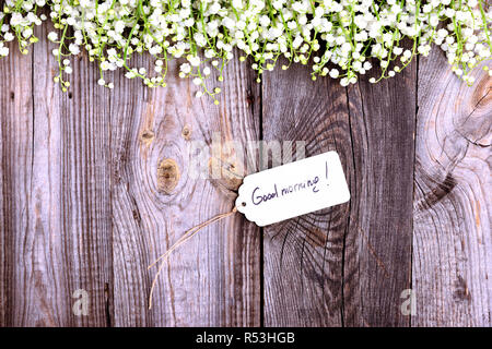 Paper tag on a rope with an inscription good morning - Stock Photo