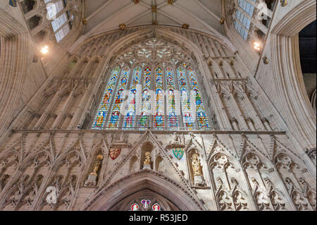 York, England - April 2018: Gothic tracery on The Great West Window called Heart of Yorkshire, installed at the nave inside York Minster, UK - Stock Photo