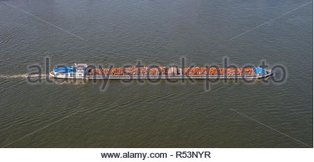 Waste disposal on cargo ship. Boat and scrap metal - Stock Photo