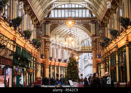 London, UK. 29th Nov, 2018. A giant decorated Christmas tree stands in Leadenhall Market one of the oldest markets in London, dating from the 14th century which is located in the historic centre of the City of London's financial district Credit: amer ghazzal/Alamy Live News - Stock Photo