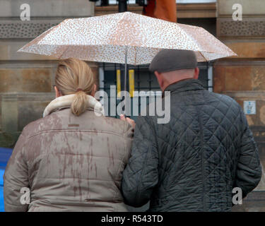 Glasgow, Scotland, UK. 29th Nov, 2018. UK Weather.Storm Diana weather warnings continue as the city gets very wet with heavy rain and locals are on the streets. Credit: gerard ferry/Alamy Live News - Stock Photo
