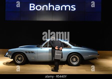 London, UK. 29th November 2018: A man looks at a 1966 Ferrari 500 supefast series II coupe at the press preview of Bonhams Sale. Credit: claire doherty/Alamy Live News - Stock Photo