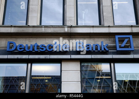 Brussels, Belgium. 29th Nov, 2018. Exterior view of Deutsche Bank branch. A large contingent of investigators searched the headquarters of the largest German money house in Frankfurt. The suspicion: Group employees helped customers set up so-called offshore companies in tax havens and launder money from criminal activities. Credit: ALEXANDROS MICHAILIDIS/Alamy Live News - Stock Photo