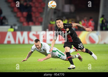 29 November 2018, North Rhine-Westphalia, Leverkusen: Soccer: Europa League, Bayer Leverkusen - Ludogorez Rasgrad, Group Phase, Group A, 5th matchday on 29.11.2018 in the BayArena. Leverkusen's Charles Mariano Aranguiz (r) and Jacek Goralski of Ludogorez fight for the ball. Photo: Federico Gambarini/dpa Stock Photo