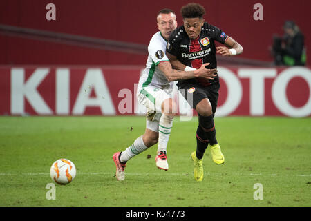 29 November 2018, North Rhine-Westphalia, Leverkusen: Soccer: Europa League, Bayer Leverkusen - Ludogorez Rasgrad, Group Phase, Group A, 5th matchday on 29.11.2018 in the BayArena. Leverkusen's Leon Bailey (r) and Jacek Goralski of Ludogorez fight for the ball. Photo: Federico Gambarini/dpa Stock Photo