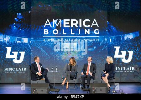 U.S First Lady Melania Trump participates in a discussion with moderator Eric Bolling, left, at an Opioid Town Hall meeting at Liberty University November 28, 2018 in Lynchburg, Virginia. From left, panel moderator Eric Bolling, Health and Human Services Secretary Alex Azar and Homeland Security Secretary Kirstjen Nielsen. - Stock Photo