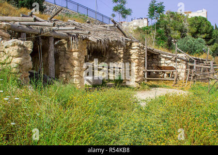 A timber built sun shade and stables in the open air museum of Nazareth Village Israel. This site gives an authentic look at the life and times of Jes - Stock Photo