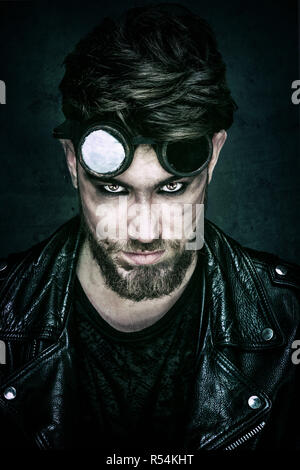Portrait of a young Hipster in leather jacket, looking towards the lens - Stock Photo