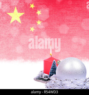 Christmas card with red candle, silver ball, fir-tree over grunge Chinese flag - Stock Photo