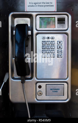 Late model BT British Telecom pushbutton / push button pay phone payphone in stainless steel which accepts coin / cash payment for phone calls. UK (98) - Stock Photo