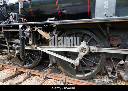 Close up of steam train wheels with Side rods / Coupling rods connecting the driving wheels of engine number 46447 together. Isle of Wight steam Railway. UK (98) - Stock Photo