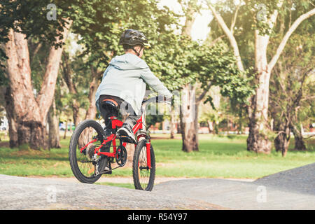 Australian boy riding his bicycles on special bike track in Adelaide, South Australia - Stock Photo