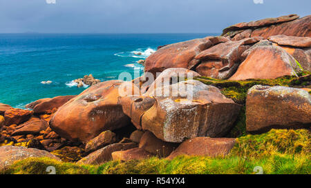 The pink granite rocks with strange shapes, coast in Brittany. The mass of enormous pink rocks, the pink granite, rock with strange shapes. Brittany ( - Stock Photo