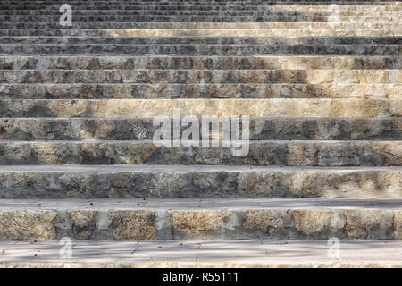 Stair steps of stone which lead upwards - Stock Photo