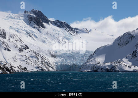 View of the spectacular Drygalski Fjord with snow covered mountains on South Georgia Island in the South Atlantic Island, Antarctica - Stock Photo