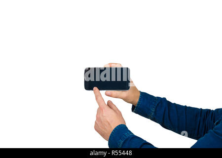 Close up of young man hands holding a smartphone, new technology presentation pointing finger on the touch screen. - Stock Photo