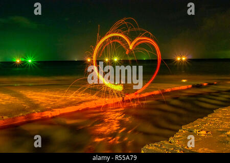 heart image from steel wool on the beach - Stock Photo