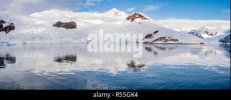 Panorama of Neko Harbour bay with glacier and red tents on camp site, Arctowski Peninsula, Antarctica - Stock Photo