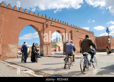 Marrakesh,Morocco-March 04,2016: Daily life at an entrance gate to the medina of Marrakesh - Stock Photo