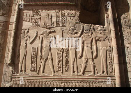 Ptolemy VI's coronation by Nekhbet and Wadjet in the Outer Hypostyle Hall of the Temple of Haroeris and Sobek at Kom Ombo - Stock Photo