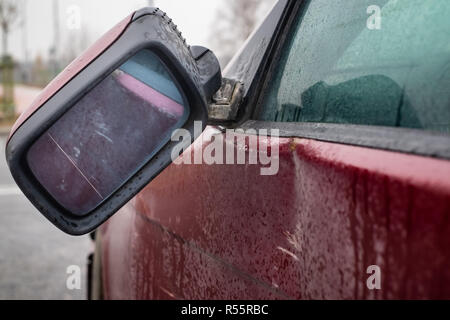 right car mirror broken after accident, subject to insurance claim - Stock Photo