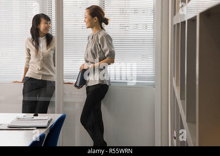 Female colleagues in office - Stock Photo