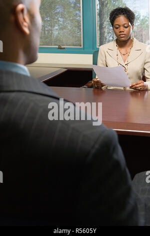 Interviewer reading resume