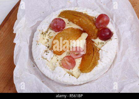 Camembert with fruit, honey and pear - Stock Photo
