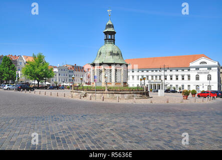 the market square in wismar with the wasserkunst,mecklenburg-vorpommern,germany - Stock Photo