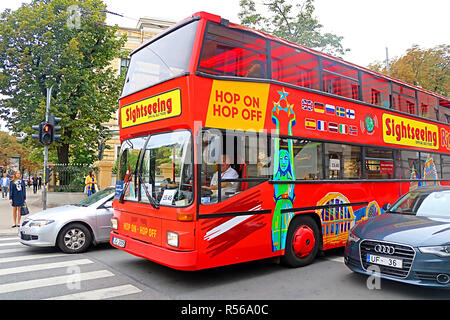 RIGA, LATVIA - AUGUST 31, 2018: Touristic red double-decker hop-on hop-off City Sightseeing tour bus on the street of Riga city - Stock Photo