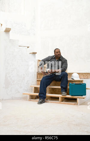A builder taking a break - Stock Photo