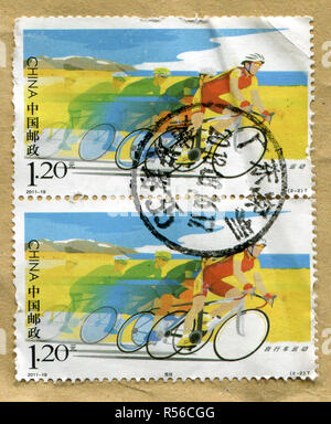 GOMEL, BELARUS, 27 OCTOBER 2017, Stamp printed in China shows image of the Cycling race, circa 2011. - Stock Photo