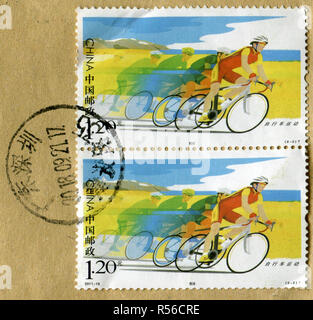 GOMEL, BELARUS, 27 OCTOBER 2018, Stamp printed in China shows image of the Cycling race, circa 2011. - Stock Photo