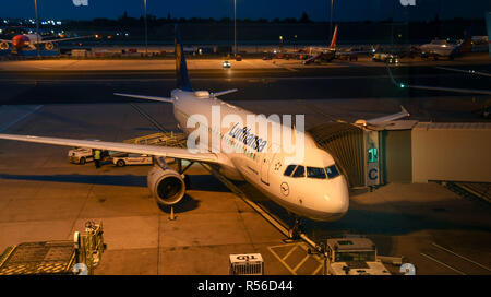 Airbus A320 jet operated by German airline Lufthansa about to push back from the terminal at Birmingham airport. - Stock Photo