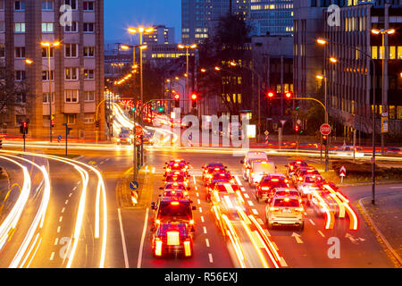 Evening city traffic in Essen, Germany, large intersection, the Bismarckstrasse, B224, Friedrichstrasse and Hohenzollernstrasse, this area would also  - Stock Photo