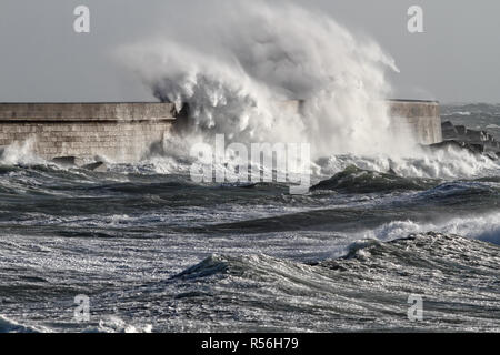 Stormy waves against Leixoes harbor north wall, Portugal - Stock Photo