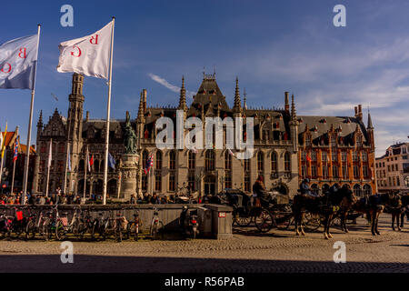 Bruges, Belgium - 17 February 2018: A horse cart is parked in front of the provincial court in Bruges, Belgium - Stock Photo