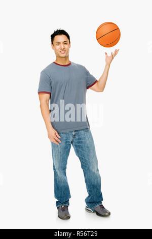 Man with basketball - Stock Photo
