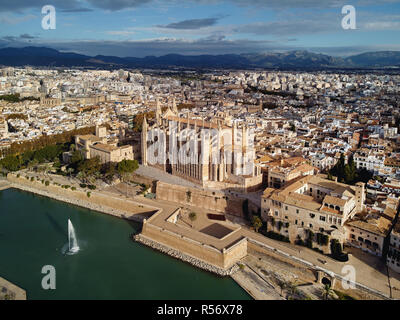 Aerial above drone view Palma de Mallorca Cathedral was built on a cliff rising out of the sea. Picturesque panorama Majorca cityscape Spain - Stock Photo