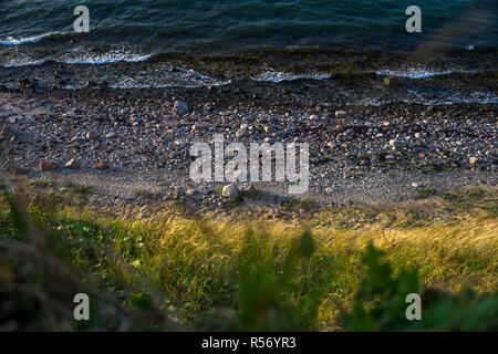 A view from the steep coast on the surf of the Baltic Sea in Schleswig-Holstein, Germany 2018. - Stock Photo