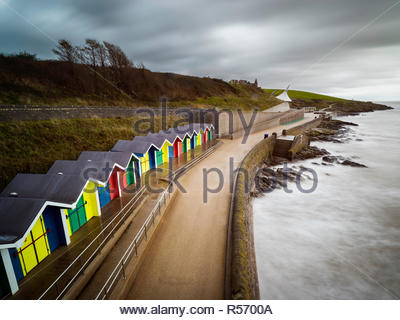 An image of Barry Island beach huts showing how vibrant they are against a dull sky - Stock Photo