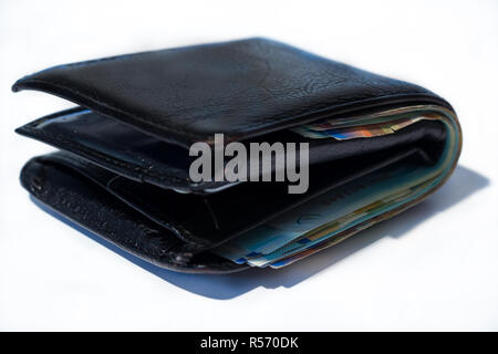 Stack of various of israeli shekel money bills in close black leather wallet - Stock Photo