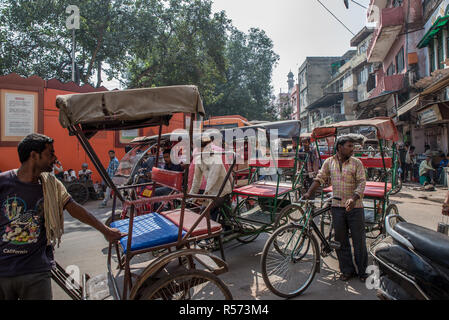 Rickshaw waiting for customers in a crowdy road, Old Delhi, India - Stock Photo