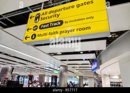 London England United Kingdom Great Britain Longford Heathrow Airport LHR terminal concourse inside interior sign departure gates security multi-faith - Stock Photo