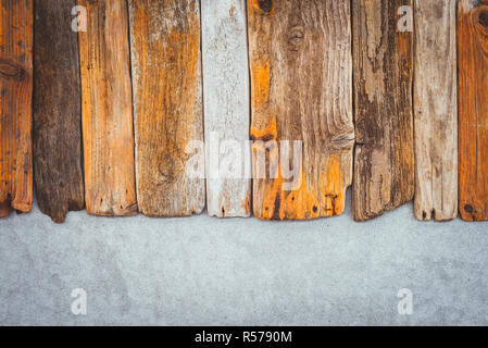 Vintage wooden planks on concrete background. Driftwood and cement texture. - Stock Photo