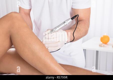 Woman having procedure of anti cellulite lpg treatment massage with